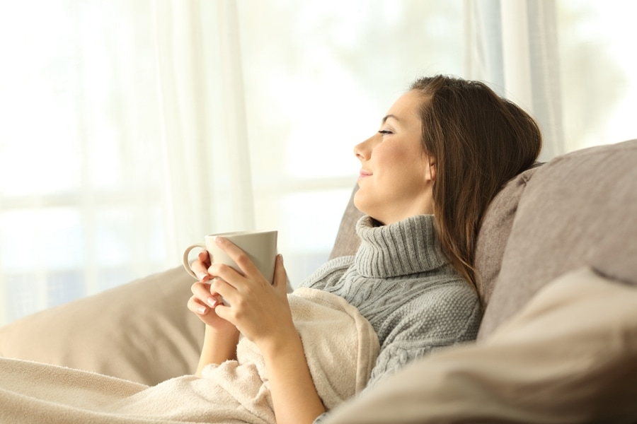 Woman relaxing in the comfort of her zone control system