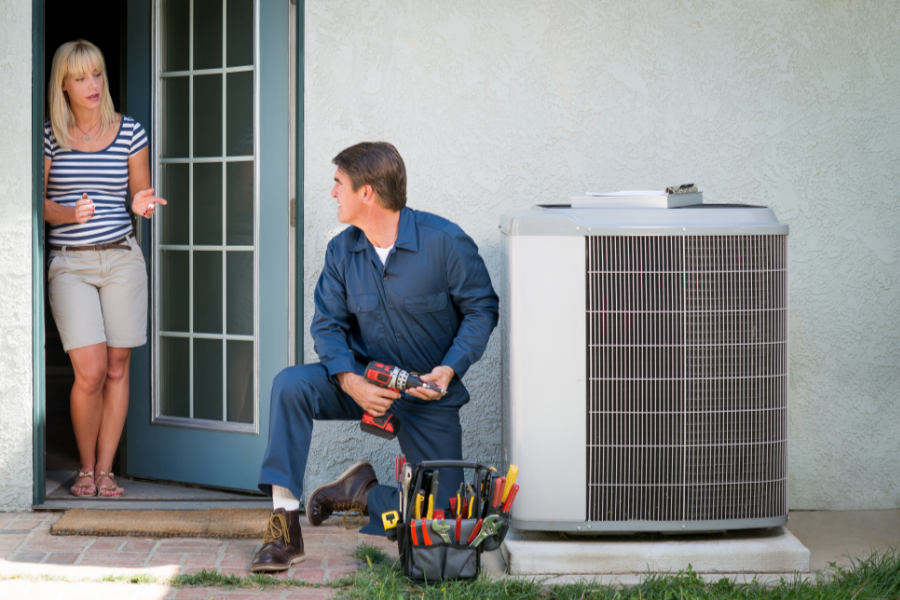 technician explaining the FAQs about the new AC regulations with a customer