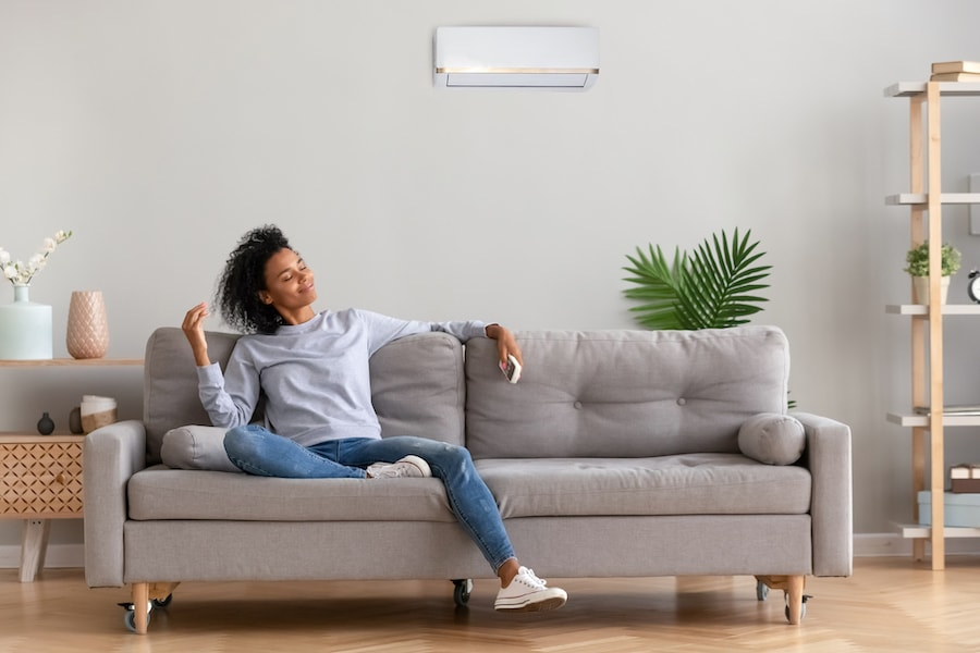 African young relaxed woman sitting on couch breathing fresh air. What Accessories Can Help With My Indoor Air Quality?