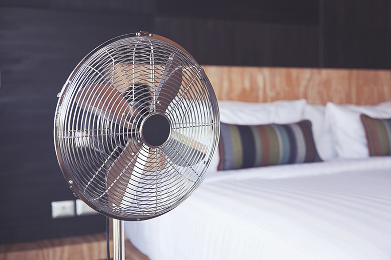 A fan next to a bed | Improve Your Home's Indoor Air Quality | Fort Collins, CO